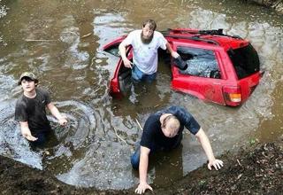 3 amigos have driven into a mud hole