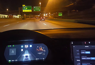 inside view of a Tesla car while on autopilot