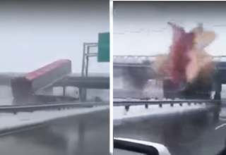 dump truck strikes overpass and explodes