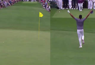 golfer on the golf course celebrating with both hands up