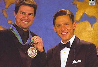 scientologist david miscavige gives a medal to actor and scientologist tom cruise