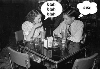 two people sitting at a table on a date