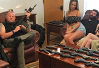 dan bilzerian in a room full of guns and girls