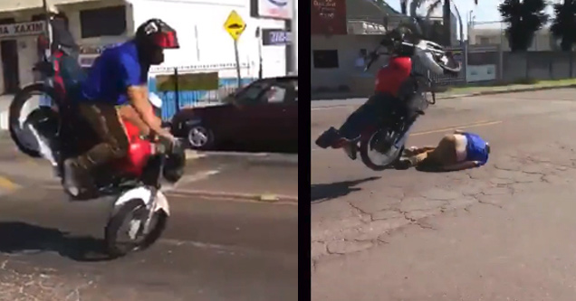 a man in blue shirt on motorcycle goes over handlebars and crashes