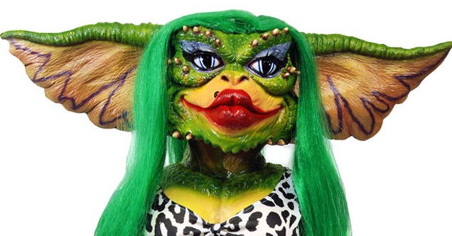 a gremlin with green hair