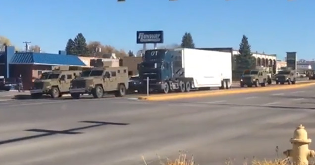 a tractor trailer with military escort