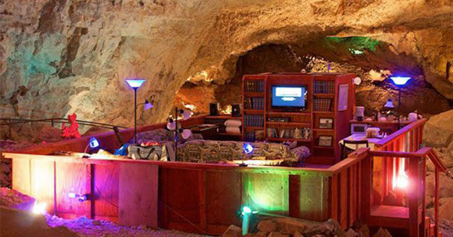 crazy cave with a tv and a couch inside