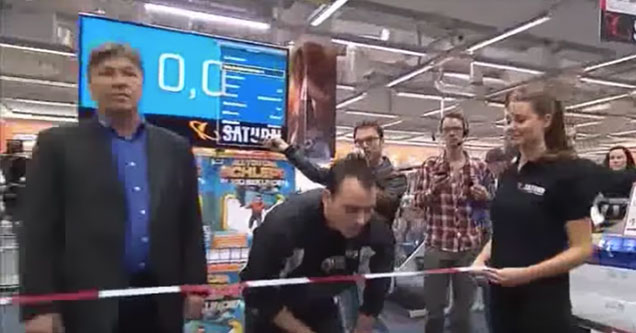 guy waiting to start a game show inside a store