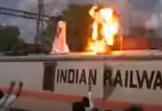 Indian protestor burst into flames while touching electric wire