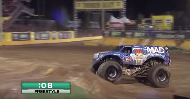 monster truck driving up to a jump