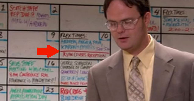 Dwight Shrute in front of a whiteboard