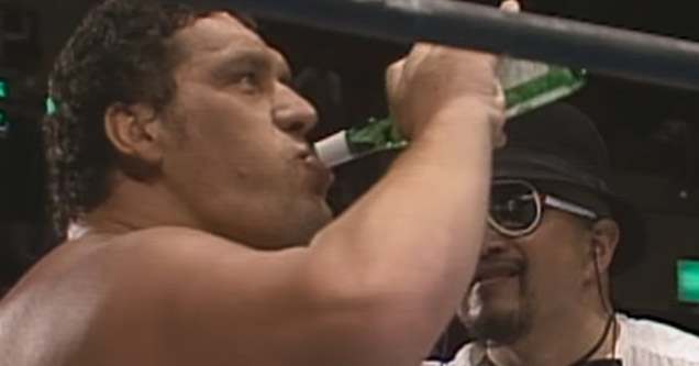 andre the giant chugging a beer in the ring