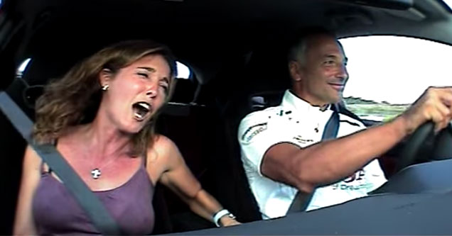 man and woman in a car going really fast