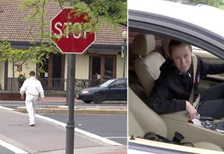 funny Video g0kv7q5y1 - man in a white jacket crossing a street behind a stop sign. A furious student looks at the reporter angrily.