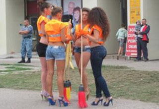 a group of hote female construction workers in booty shorts and high heels