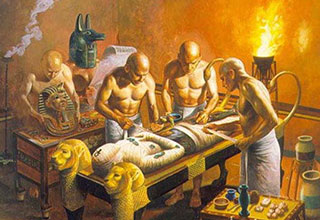 Egyptians making a mummy