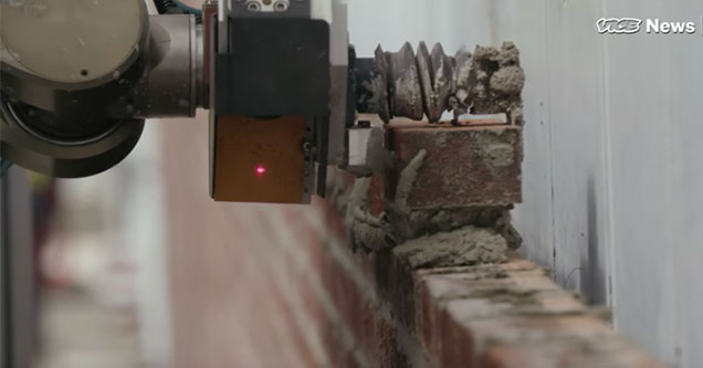 close up of a brick laying robot
