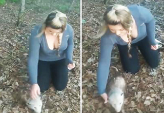 busty woman approaches possum for licking
