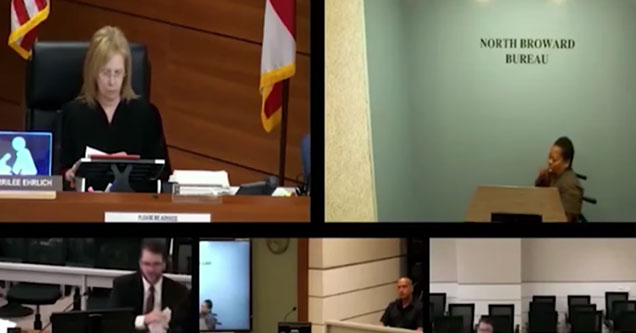 video of a courtroom where a judge talks to a woman in a wheelchair