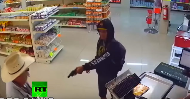 a robber with a gun pointing it at an old man wearing a  cowboy hat