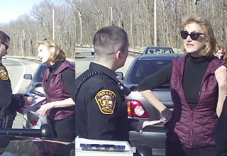 caren turner looking frustrated at the Tenafly police on the roadside wearing a purple vest
