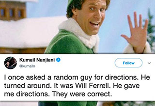 will ferrell in elf garb waving to the camera in a snowy scene