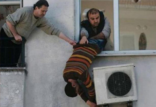 man falls out of window