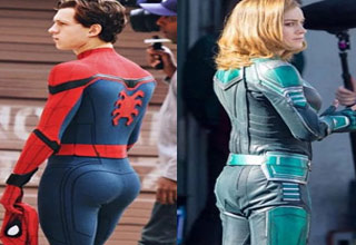 sipderman has a bigger booty than female super hero next to him