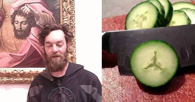 guy standing in front of a piece of art with a decapitated head that looks like him, a cucumber being slice and it looks like the and one symbol
