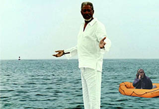 morgan freeman standing on water with the lady who called the cops in oakland on an orange raft in the background. - BBQ Becky