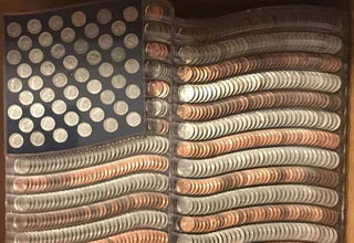 an american flag made of silver coins and pennies
