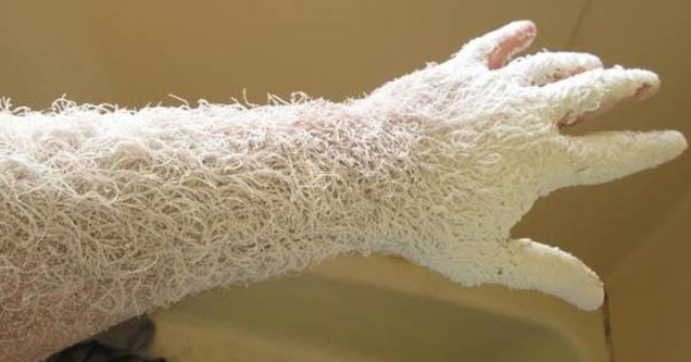 a mans arm covered in saw dust