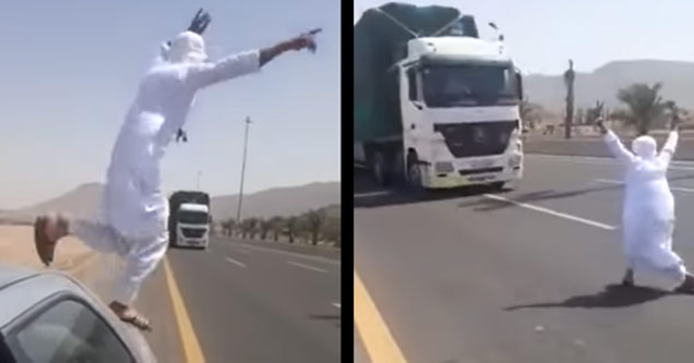man in white clothing jumps in front of an oncoming semi truck