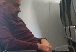 Michael Allen Haag urinating on frontier airlines