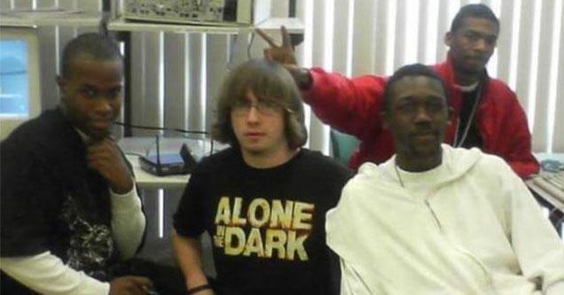 white guys sitting with three black guys