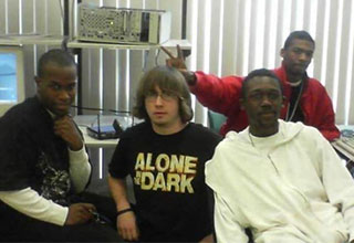white guys sitting with three black guys