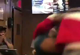 Gasping mcdonalds employee watches as a man hurls another
