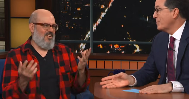 david cross wearing a red flannel shirt on the stephen colbert show