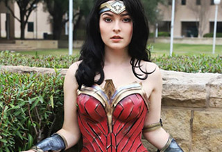 a good looking brunette woman in wonder woman cosplay