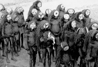 a group of children wearing creepy masks