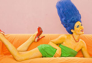 Marge Simpson cosplayer laying on a couch