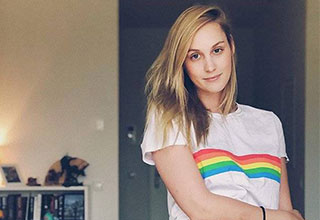 cute girl in a rainbow shirt