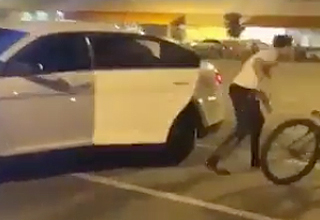 Guy Lets His Buddy out of Cop Car