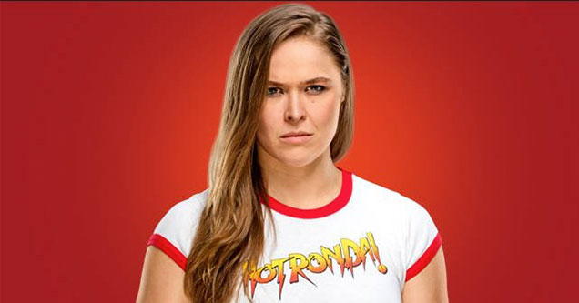 Rhonda Rousey mean mugging in front of a red backround