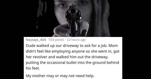 lady holding a gun toward the camera