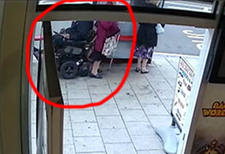a lady with a wheelchair right next to her circled in red