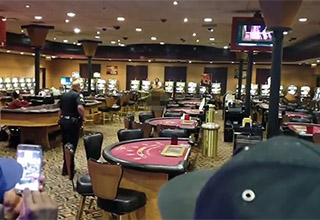casino with a cop staring down a naked man