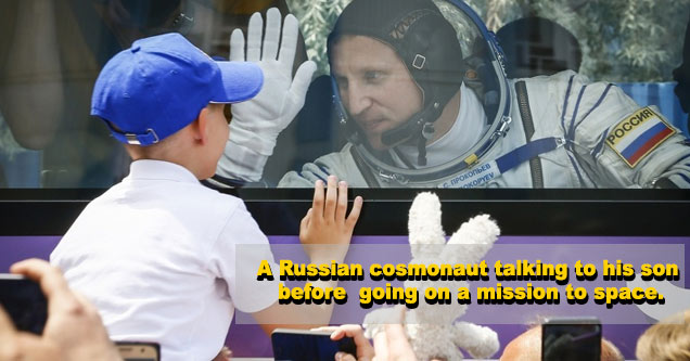 a young boy talks to his astronaut father before a mission