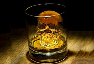 ice shaped like a skull in a glass