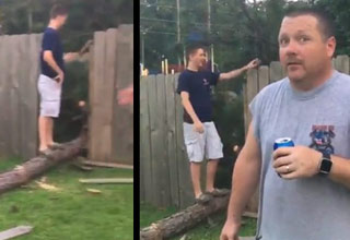 a kid standing on a tree that fell through a fence and a drunk guy in gray shirt holding a beer